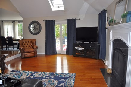 West Barnstable Cape Cod vacation rental - Family Room with Slider to Deck overlooking pool