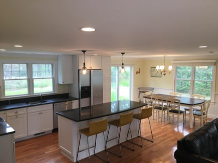 Chatham (Ridgevale) Cape Cod vacation rental - The kitchen and dining area with sliders to the backyard patio.