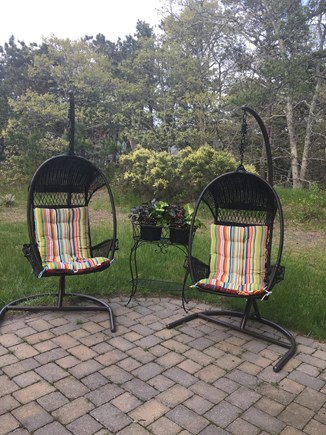 Chatham (Ridgevale) Cape Cod vacation rental - Swing chairs on the patio.