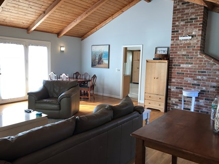 Yarmouth Port Cape Cod vacation rental - Living room with direct access to outdoor patio with grill and