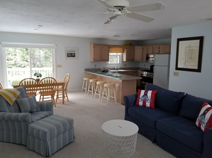 Mashpee, Popponesset Cape Cod vacation rental - Large open living & dining area open the sliders to a large deck