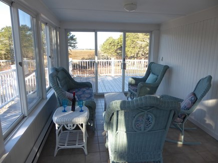 North Eastham Cape Cod vacation rental - Screened sun room facing front deck, marsh, and bay.