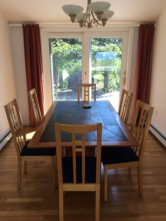 North Eastham Cape Cod vacation rental - Dining area facing back garden.