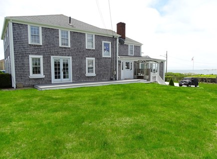West Yarmouth Cape Cod vacation rental - Back yard showing deck and water views