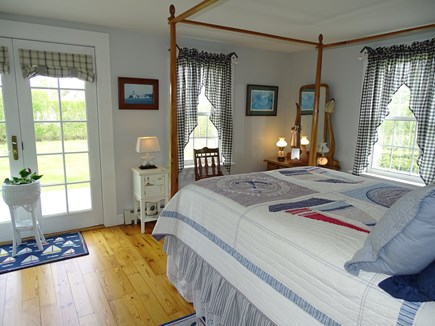 West Yarmouth Cape Cod vacation rental - Canopy bedroom on first floor, opens to deck