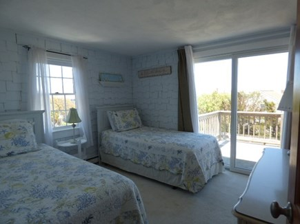 Dennis Cape Cod vacation rental - 2nd Bedroom with twin beds and slider to back balcony and views.