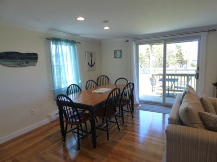 Dennis Cape Cod vacation rental - Dining area next to Living room & slider to back Deck