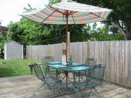 Hyannis Cape Cod vacation rental - Private back deck with furniture. Gas grill is provided
