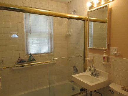 Hyannis Cape Cod vacation rental - Full bath, glass shower doors, and pocket door for privacy