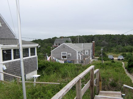 East Sandwich Cape Cod vacation rental - View from the ocean, looking back at the three cottages in a row.