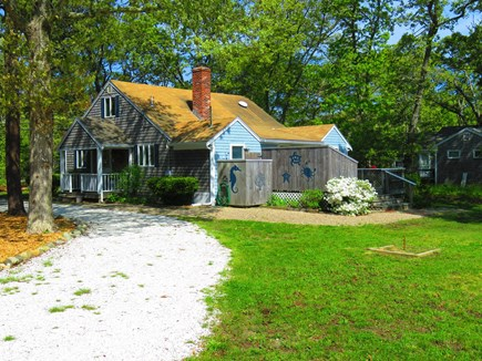 Eastham Cape Cod vacation rental - Front of house showing the side porch steps and horseshoe pit.