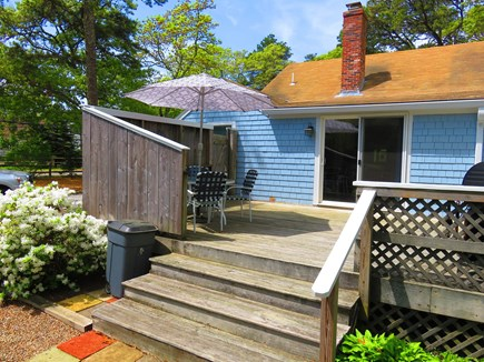 Eastham Cape Cod vacation rental - Large private back deck with seating, grill, and outdoor shower.