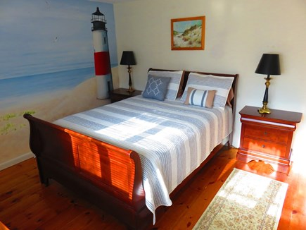 Eastham Cape Cod vacation rental - Master bedroom with a beach scene.