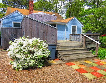 Eastham Cape Cod vacation rental - Steps up to the back deck from the horseshoe pit.