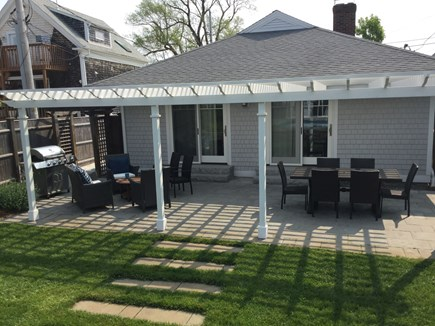 Provincetown Cape Cod vacation rental - Backyard - patio with pergola, grill, tables and chairs