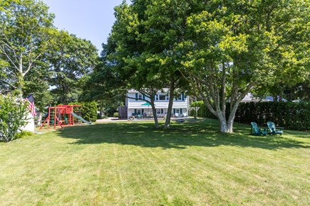 Mashpee, Popponesset Cape Cod vacation rental - View of back yard from dock