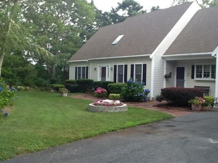 Yarmouth Cape Cod vacation rental - Front of the house with beautiful garden, at end of long driveway