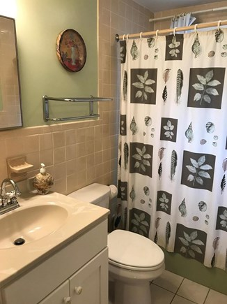 Truro Cape Cod vacation rental - First floor full bathroom, new vanity and regrouted tile.