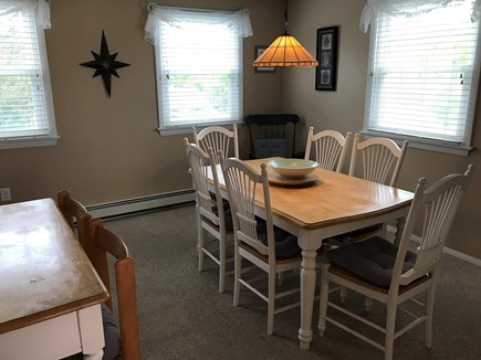 Truro Cape Cod vacation rental - Carpeted dining room with seating for 8.