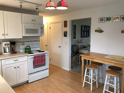 Truro Cape Cod vacation rental - Kitchen showing table & stools looking towards other rooms.