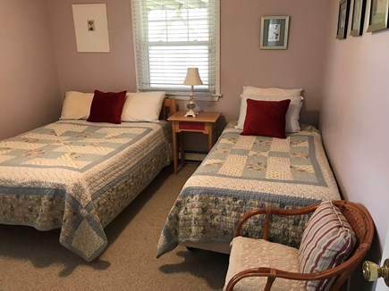 Truro Cape Cod vacation rental - First floor bedroom with double and twin beds.