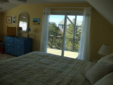 Truro Cape Cod vacation rental - Sunny 2nd floor king bedroom showing sliders to second floor deck