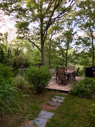 Eastham Cape Cod vacation rental - Outdoor Dining Space Overlooking Terraced Lawn