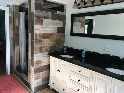 Eastham Cape Cod vacation rental - Large Second Floor Bath—tile, granite, pebbled shower floor...