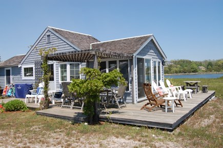 Wellfleet Cape Cod vacation rental - Outdoor deck with lounge chairs and dining table!