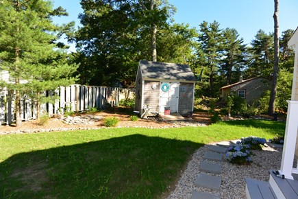 Mashpee, John's Pond Cape Cod vacation rental - Path to outdoor shower off of Master Bedroom