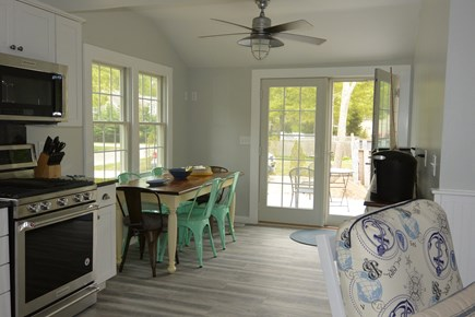 Mashpee, John's Pond Cape Cod vacation rental - Kitchen and dining room with views of the lake