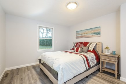 East Falmouth Cape Cod vacation rental - Queen bedroom with 1/2 bath attached
