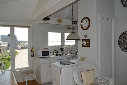 Provincetown Cape Cod vacation rental - Galley kitchen is to the right. Truro is in the background.