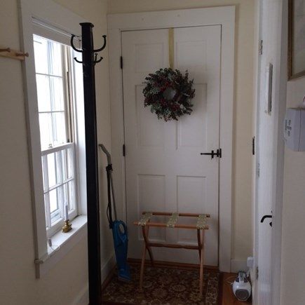 Truro Cape Cod vacation rental - End of Hallway leading to Main House - a good nook for suitcases