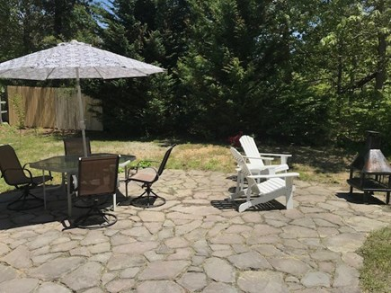 Eastham Cape Cod vacation rental - The slate patio provides the perfect setting for eating outdoors.