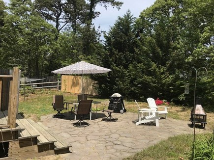 Eastham Cape Cod vacation rental - View from the side yard of the patio with amenities.