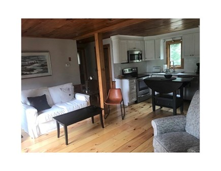 Eastham Cape Cod vacation rental - Living area with couch and recliner.  Kitchen in the background.