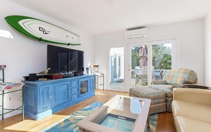 Eastham Cape Cod vacation rental - Spacious family room with flat screen tv and sliders to back deck