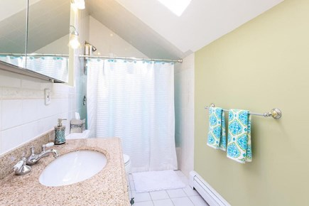 Eastham Cape Cod vacation rental - Upstairs bathroom with skylight, tub and shower