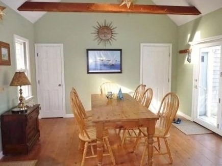 Eastham Cape Cod vacation rental - Lg dining table in open LR w vaulted ceiling, slider to back deck