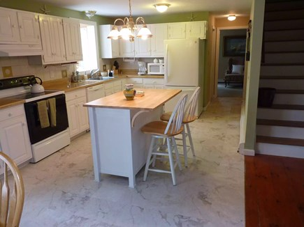 Eastham Cape Cod vacation rental - Bright and open kitchen adjacent to DR, view of private yard/deck