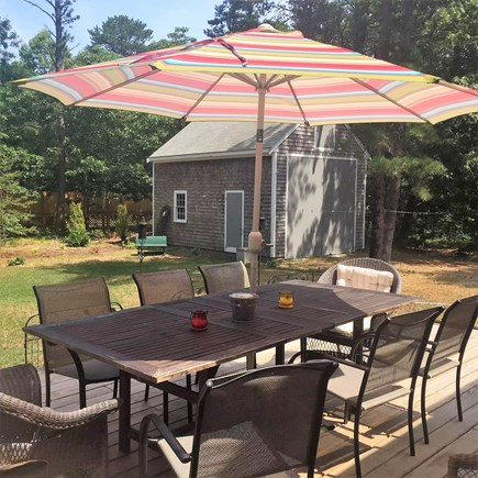 Eastham Cape Cod vacation rental - Very private back deck w space for everyone at the dining table.