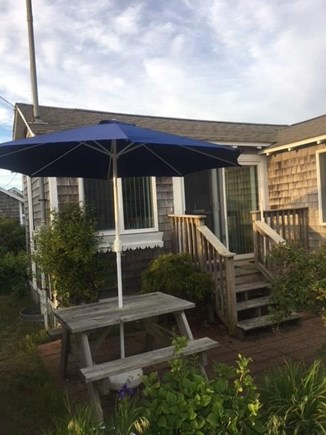 Dennis Port Cape Cod vacation rental - Front patio with picnic table and umbrella for sunset viewing!