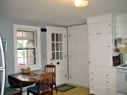 South Harwich Cape Cod vacation rental - Kitchen- Front Side Entry, Garage Door, Table/ Chairs