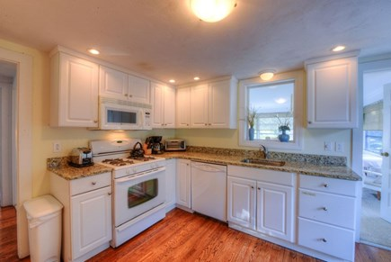 West Hyannisport Cape Cod vacation rental - Kitchen with gas stove and dishwasher