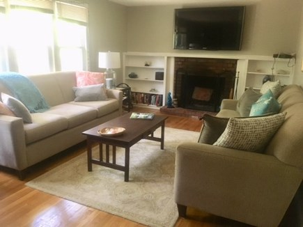 Barnstable Village Cape Cod vacation rental - Living room with TV,  Sonos music player, puzzles, games, books