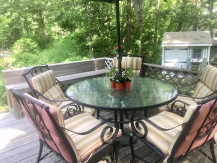 Barnstable Village Cape Cod vacation rental - Enjoy breezes, birdsong, and memorable meals on the deck.