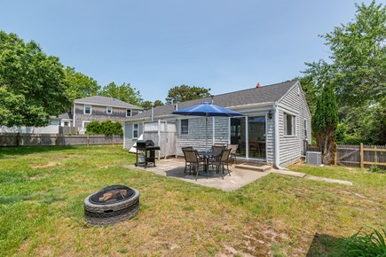 West Yarmouth Cape Cod vacation rental - Back yard with fire pit and views of the outdoor shower