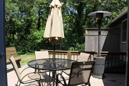 Eastham Cape Cod vacation rental - Deck with outdoor shower and patio and fenced yard