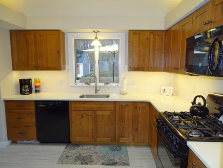 Eastham Cape Cod vacation rental - Kitchen view from living room, new cabinets